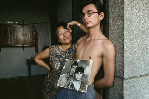 "Amerasian Portrait, 2009: ""Jim and his Vietnamese mother with photo of her and her American husband, Jim's father"""